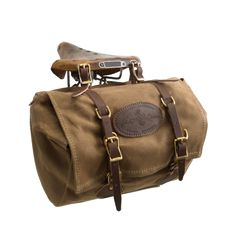 A medium size, traditional style canvas saddlebag made by Frost River in Duluth…