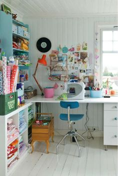 Using the low box shelving unit, could make a sewing nook like this.