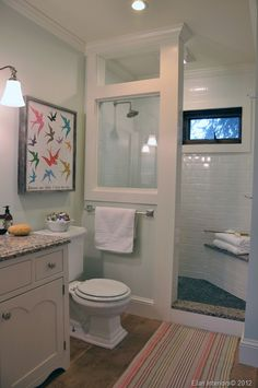 Love this open shower in a small bathroom. Blog has floor plan included.