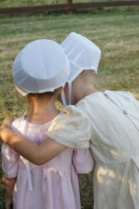 Cute little #Amish girls sharing a secret #AmishCountry
