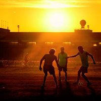 Football being played on the fields outside the closed Berlin Tempelhof airport in Germany.