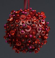 rich red buttons on this ornament.