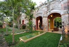 Hacienda near Acanceh about 30 minutes from Merida available for vacation rentals at Best of Yucatan and Urbano Rentals    The portico is surrounded by lily ponds.  There is outdoor living and dining space that adjoins the Casa Vieja to the Casa Nueva