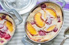 Fresh Peach & Raspberry Clafoutis is a traditional French dessert made with seasonal fresh fruit, covered in a thick custard-like batter, then baked.