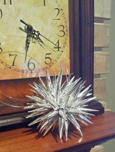 DIY Polish Star tutorial. Polish Stars make excellent ornaments, gift toppers or holiday decorations. Use aluminium foil, scrapbook or wrapping paper to get the look you want.