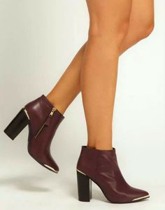 Burgundy ankle boots with golden details