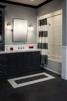 There's nothing more classic than a black & white bathroom with subway tile and penny rounds. #thetileshop