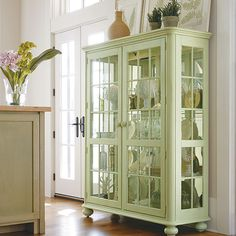 I really like this simple, warm, china cabinet.