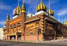 """Corn Palace Mitchell, S.D. It's almost beside the point that the Corn Palace is actually a multipurpose arena. The draw here is the circa 1921 fantasy architecture straight out of The Arabian Nights that's adorned with huge murals made from 275,000-plus ears of multicolored corn. It's """"corny"""" in both senses of the word."""