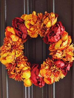 Add a burst of bold fall color to your front door with a beautiful floral wreath that couldn't be si... - abeautifulmess.com