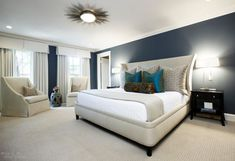 Love the color pallete of this bedroom... deep midnight blue hue partnered w/ light colored flooring...