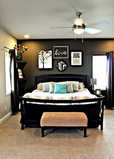 Master bedroom with dark grey accent wall, light grey walls, dark furniture and fun accent colors!