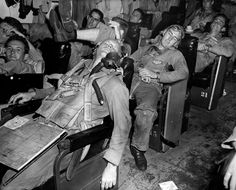 Exhausted US Navy pilots catching a few winks in the Ready Room, November 1944