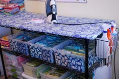 Ironing station: 20x60 piece of MDF board, covered in batting and fabric on top if a shelving unit. Also info on folding fabric.