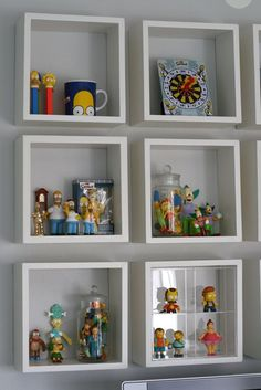Displaying the Simpsons: stunning idea how to keep these small things visible and still clean.  Yet it's suitable for a grown up kids if glass containers are used...