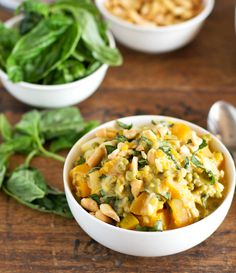 Thai basil coconut lentils in bowls with basil on the side.