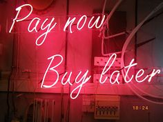 'Pay now Buy later' neon by artist Arnaud Cohen
