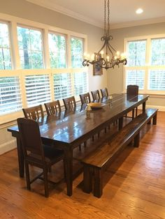 "James+James: 13' L x 42"" W Farmhouse Table with a traditional top and tapered legs in Dark Walnut stain with a semi-gloss finish. Pictured with a matching Farmhouse Bench, William Dining Chairs, and antique end chairs."