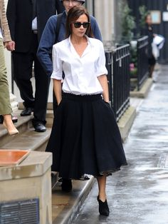 monochrome. black & white. victoria beckham. full skirt. skinny booties.