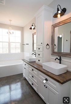 Easy Ways To Love Your Home; Farmhouse Bathroom Decor Ideas As far as home-improvement projects go, it's not the scale of the changes that you make. Wooden Bathroom Vanity, Modern Bathroom, Small Bathroom, Wood Counter Bathroom, Vessel Sink Bathroom, Bathroom Vanities, Bathroom Countertops, Bathroom Vanity With Drawers, Bathroom With Wood Floor