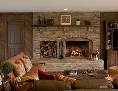Living Room:Fabulous Rustic Stone Fireplace Design Along With Built In Firewoods Storage Aside In A Warm Living Room With Comfort Sofa And Brown Table How to Make Masculine Interior for Male Living Room on a Budget
