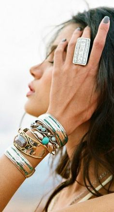 Stacked bracelets and unique ring-love! Touches of turquoise are pretty...would love this with white tee or shirt!