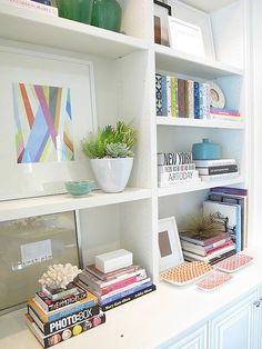 How to Style Bookshelves- Ideas and tips, including this from Amber Interior Design...