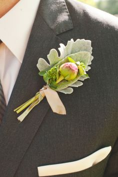 dark grey suit.  And the leaf boutonniere