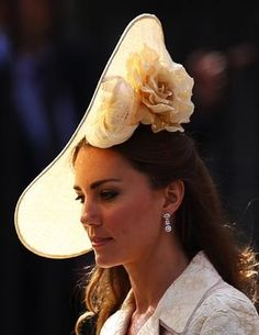 1. This hat worn by the Duchess of Cambridge, Kate Middleton when she attended Queen Elizabeth II's eldest granddaughter, Zara Phillips royal wedding on July 30th 2012. She looks beautiful with her cream-colored hat with flower accent on the side.
