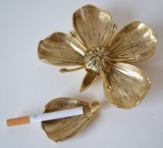 how cool is this?  vintage gucci brass flower pedal ashtray.  its cool.