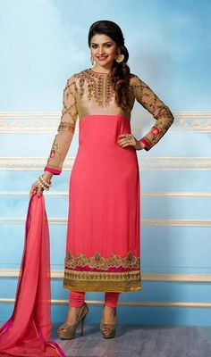 Prachi Desai in rose pink georgette dress is perfect for evening party requirement. The long straight cut dress is embellished with golden woven lace, silk thread embroidered border and upper bodice and crystal stones which gives you an elegant look. The dress comes with matching dupatta and churidar. #NewBollywoodEmbroidredDresses