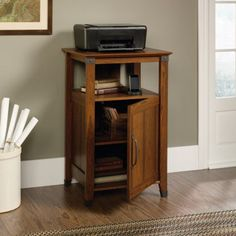 Sauder Carson Forge Technology Pier Free Standing Cabinet, Washington Cherry Finish Carson Forge reminds us of the quality with which American products can Utility Shelves, Storage Shelves, Storage Spaces, Shelf, Printer Storage, Printer Stand, Free Standing Cabinets, Organizing Your Home, Wood Cabinets