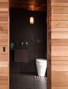 A petite bathroom goes big on rustic texture