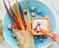 These ain't your mamas carrot sticks. We're crushing on these roasted rainbow carrots and rosewater tahini dip for gorgeous summer snacking all season long...