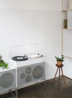 an aesthetic sound system via the design chaser of thisisipaper flagship store commercial interiors