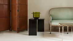Eric Schmitt patinated bronze side table and vase; Paul Mathieu 'Aria' side table, bronze