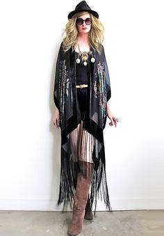 "Stunning 1920's art deco inspired kimono.  Beautiful long silk flowing fringe all around bottom.  Gorgeous floral design in front and back with hand beading on a very high quality silk velvet burnout.   Hangs open, with no closures with an effortless and ultra flattering drape.Also available in Lilac and RedOne size fits allOverall length including fringe is 48""Dry CleanThe velvet burnout process, or ""Dévoré"" as it is also referred, is achieved by applyi..."