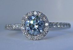 Solitaire  round blue saffire engagement ring. My birthstone too, I need this!
