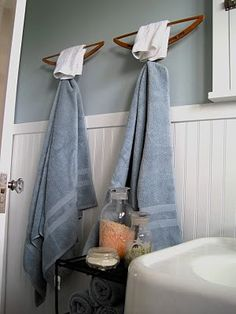 Wooden coat hangers repurposed as bath towel rack and hook. What a creative idea!
