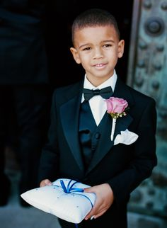 The Ring Bearer Donned A Tuxedo And Bow Tie With Pink Rose Boutonniere He