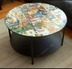 Thrift store glass top coffee table transformed with an insert of collaged beer coasters