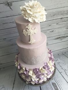 Lilac Baptism Cake Made this cake for my nieces baptism. Used the flower method for the ruffles(it took forever!). Cake lace for the middle...