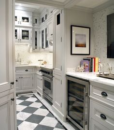 Small White Kitchen With black and white floor