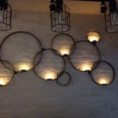 Wall-mounted votive candle holder of many circles More