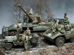 Battle of the Bulge diorama:  Jeep, Greyhound armored car pass by knocked-out Tiger II.