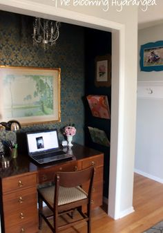 gorgeous closet office space - love the stuff on the right wall!