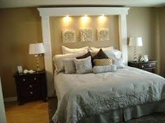 """Cool """"headboard"""" made with molding and artwork"""