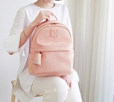 0869d3df5773 110 on the real site - Nuevo mini office leather backpack with tassel by  Monopoly. The Nuevo mini office backpack is perfect for school