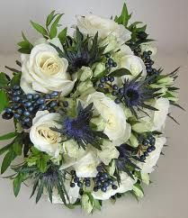 very natural bouquet that incorporated English roses and Scottish thistles. Large headed roses were combined with spray roses, the blue Eryngium, myrtle and viburnum tinus berries Rose Wedding Bouquet, Blue Wedding Flowers, Bridal Flowers, Floral Wedding, White Flowers, Black Roses, White Rose Bouquet, Silk Flowers, Elegant Wedding