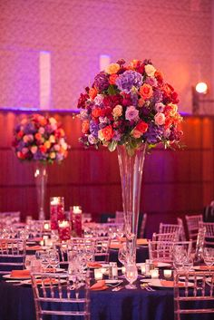 Beautiful sunset colors create this magical tablescape in purples, pinks, greens, oranges, and more. Sunset wedding theme.
